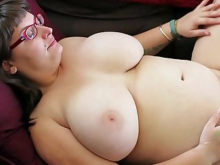 Betty fingers her hairy pussy